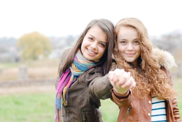 Two young girls with one wearing braces
