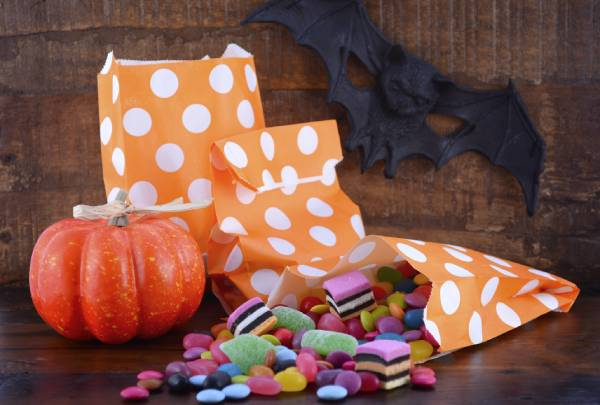Braces safe candy for Halloween with bags and a decorative pumpkin