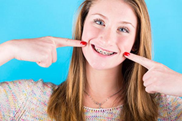 Smiling Girl Wearing Braces
