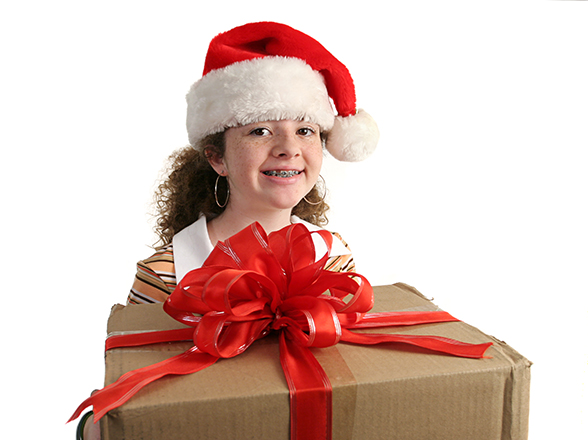 Girl with braces and holiday food for kids with braces