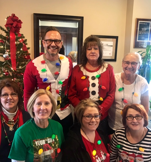 Dr. Andrew W. Skorobatckyj and his team dressed for Christmas